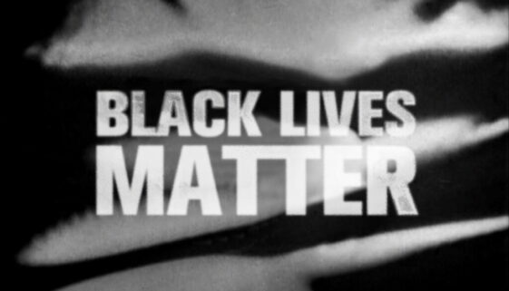 """""""Black lives matter #DoctorWhoBlackout"""" in white over Classic Who title card background"""